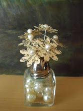 Little Flowers In Saltshaker Vase made from old book pages and maybe even a hymnal or sheet music.  These little flowers are soo different from the normal run of use of antique pages.  This looks like a petite flower with a lot of potential variations.  Have fun!!