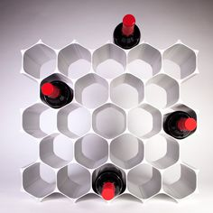 Crafted out of recyclable aluminum, the WineHive is a modular honeycomb wine rack that can continue to grow along with your wine collection.