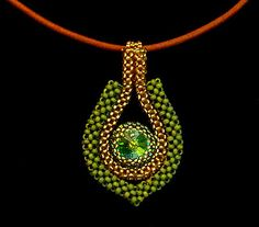 Cubic right angle weave pendant inspired by another on this board: http://www.pinterest.com/pin/379217231095106040/