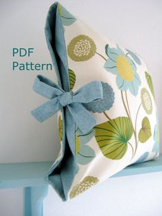 love this simple tied pillow, so elegant making great use of 2 fabrics for maximum contrast