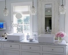 beautiful white bathroom....love the light fixtures!