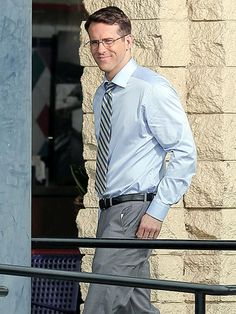 Ryan Reynolds got into character for a new movie in a professional ensemble, topped off with sleek metal oval specs!