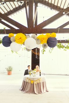 Reception tables. Wedding colors: Navy blue, pale yellow, and light gray. LOVE!