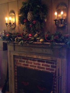 Fireplace decorated in Early Colonial for Christmas.