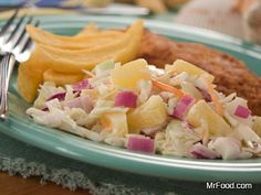 Tropical Coleslaw - We've put a fun 'n' fruity twist on your traditional coleslaw recipe, making it a fun, summer deli salad to serve at parties, potlucks, and more!