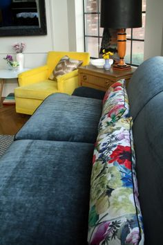 floral pillows on velvet couch