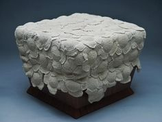 modern furniture cover made of simple crochet motifs sewn together