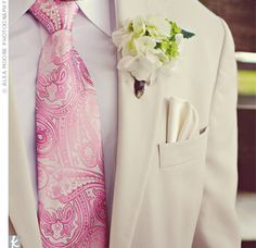 Josh's groomsmen sported clusters of miniature green hydrangeas and fiddlehead ferns for a masculine style that matched the bouquets.