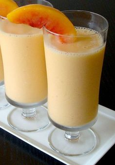 (Summer) Peach Smoothie 2 cups fresh orange juice 1 cup peach greek yogurt 2 cups frozen sliced peaches 2 tablespoons raw honey or 1 tablespoon sugar 1 teaspoon nutmeg Blend all the ingredients until smooth..