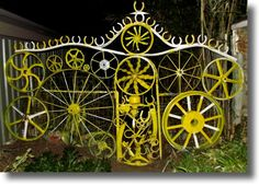 Buggy wheels, sulky wheels, horse shoes, machinery parts gate & fence  - Peter Brooks Recycled Waste / JunK Art Mudgee Australia