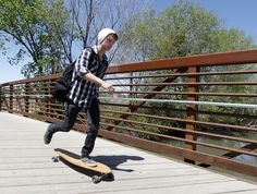A skateborder crosses the Jordan River on a bridge at 1800 North Redwood Road in Salt Lake to access one of the last sections of the Jordan River Parkway Trail to be completed. (Al Hartmann     The Salt Lake Tribune)