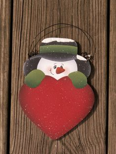 Snowman holding Heart Wood Christmas Ornament Hand painted. $10.00, via Etsy.