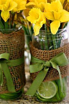 Mason jars, burlap, ribbon and budget-friendly daffodils create a unique centerpiece design