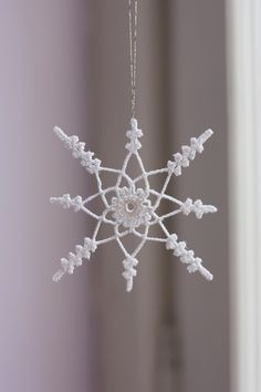 Beautiful inspiration to #crochet your own snowflakes this winter season. Find some worsted weight yarn or even cotton thread to make unique snowflakes to hang inside your home.