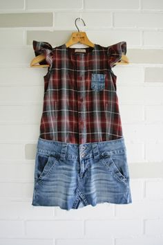 An upcycled dress for a tween, made of an old pair of denim cut-offs and a mens dress shirt.