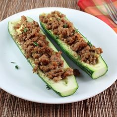 Ground pork seasoned with sage and Dijon mustard served in a tender roasted zucchini.