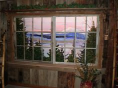 Fake window in a basement.  They used different fake christmas trees to make it more believable.