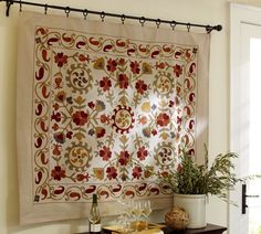 a tapestry. slide it over and you've got a blank wall to use for projector screen.