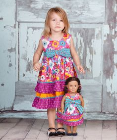 Cute matching dresses for child & doll.