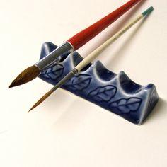 Handmade pottery brush rest, LOVE this idea.