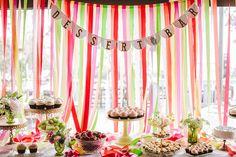 cake table with a streamer backdrop, photo by Orange Owl Photography http://ruffledblog.com/a-whimsical-bohemian-wedding-in-la-jolla #weddingideas #caketables