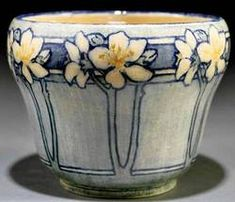 Newcomb College art pottery high glaze jardiniere 1908, decorated by Florence M. Jardet with a motif of ornamental pear tree blossoms