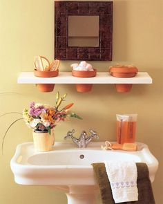 Creative storage above the sink using terra cotta pots