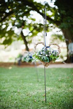 hanging rustic heart & floral ceremony decor