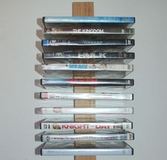 Home-Dzine - How to make a DVD storage rack - I often get asked to make a DVD storage rack and have only now realised that I don't yet have one on the Home-Dzine website. There are many options for storing DVD's: from DVD cabinets, DVD shelves and DVD units, but this DVD storage rack is simple to make and won't cost a fortune. Plus, you can make it as large or small as you want. So, here's how to make a DVD storage rack... http://www.home-dzine.co.za/diy/diy-dvd.htm#