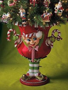 Add a little cheer to your Christmas display this year with the Holiday Elf Urn that boasts a joyful expression and vibrant colors that are sure to brighten your home.