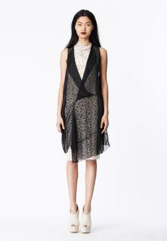LOOK 6 Black chiffon asymmetrical sling dress over a white honeycomb lace cowl neck sheath.