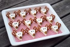 Love this idea!! Reindeer - Made with Laughing Cow spreadable cheese triangles with pretzel twist antlers, peppercorn eyes and olive noses.