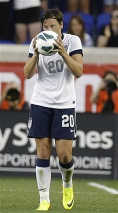 Abby Wambach kissing the ball she scored her record breaking 159th goal with.