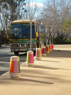 bollards outside the gallery    these knits were done by Knitta Please. They were loosley done by machine with no bind off so they could fit.