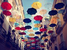 Umbrellas hanging in the street, Alicante, Spain.