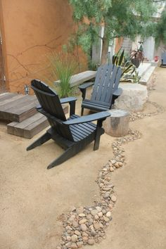 love the contrast in texture of the 'dry river bed' adds motion to the patio and can be used to define spaces