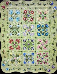 My Lively Flowers by Loretta Ockwell and Krista Moser, 2012 Pacific West Quilt Show, hand appliqued.   Posted by Pacific Fabrics.  Possibly a variation of 'Aunt Millie's Garden' by Piece o' Cake Designs.