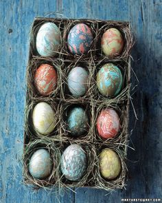 Easter eggs marbelized with oil.  So cool.
