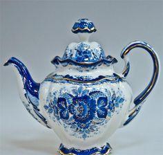 Russian majolica teapot-an uncharacteristically happy tea pot?
