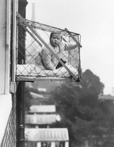 Baby cages used to ensure that children get enough sunlight and fresh air when living in an apartment building, ca. 1937