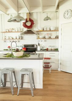 Open, hanging shelves and subway tile