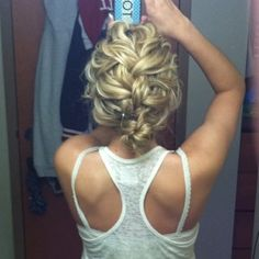 Adore this loosely braided up do.