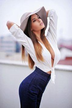 Sexy Spanish girl see through tied shirt