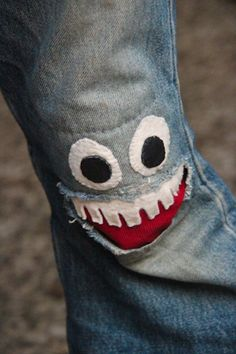 Heal jeans with a monster mouth patch.