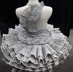 Five very different dresses made using recycled paper.