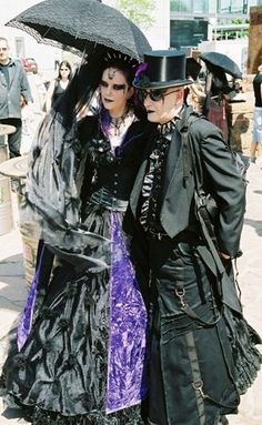 Goth Couple with Parasol by fluffy_steve, via Flickr