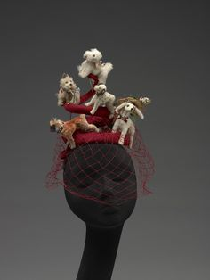 Hat (Dogs), Bes-Ben (American, 1898-1988): ca. 1950's,   synthetic and natural fibers, fur pelts, feathers, glass, metal, plastic, straw, paint, paper, adhesives. [I find that I'm more than fond of this. Please note that one of the dogs in front is wearing a lovely hat. Therefore there are dogs on the hat and a hat on the dog on the hat.]