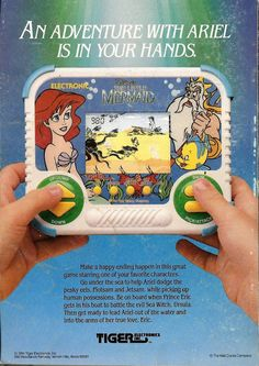 I LOVED this game.   Little Mermaid handheld game by Tiger