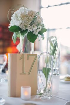 A Library Wedding -- with Books Used for Table Numbers | On SMP: http://www.StyleMePretty.com/tri-state-weddings/2014/02/11/library-wedding-at-new-york-academy-of-medicine/ Paul Francis Photography