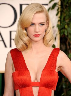 January Jones plunging cleavage in a red dress